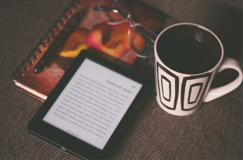 Kindle and cup of coffee